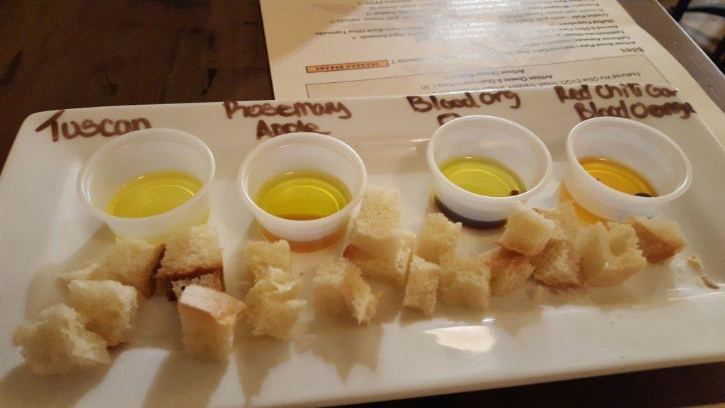 we olive tasting olive oil plate